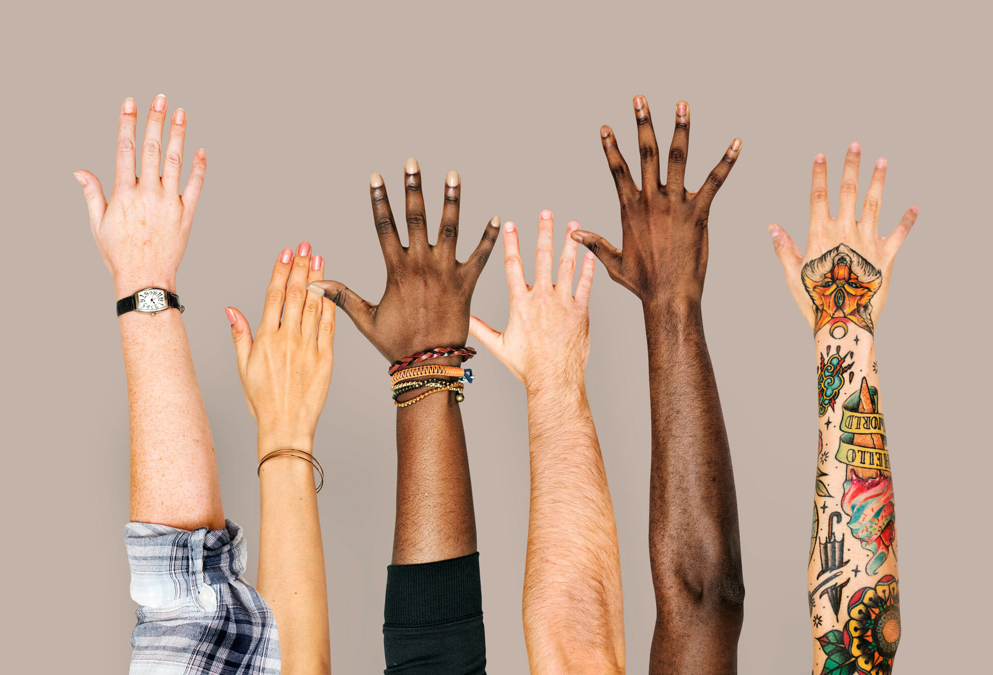 Hands and arms of diverse humans.